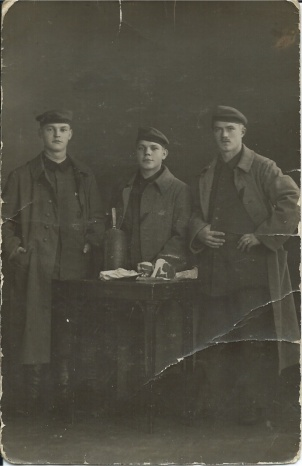 My Granddad in Verdun 1915 (centre). Note that soldiers were photographed with food on a table to show family back home they were getting plenty to eat!